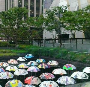 umbrellas - collaborating in the rain at Seoul city Hall
